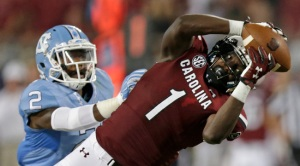 South Carolina's Deebo Samuel (1) reaches for a pass as North Carolina's Des Lawrence (2) defends in the second half of an NCAA college football game in Charlotte, N.C., Thursday, Sept. 3, 2015. The pass was incomplete. South Carolina won 17-13. (AP Photo/Chuck Burton)